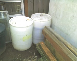 Umm...the 30 gallon barrels that came with the oil. Not nearly enough to hold it all, but a start...